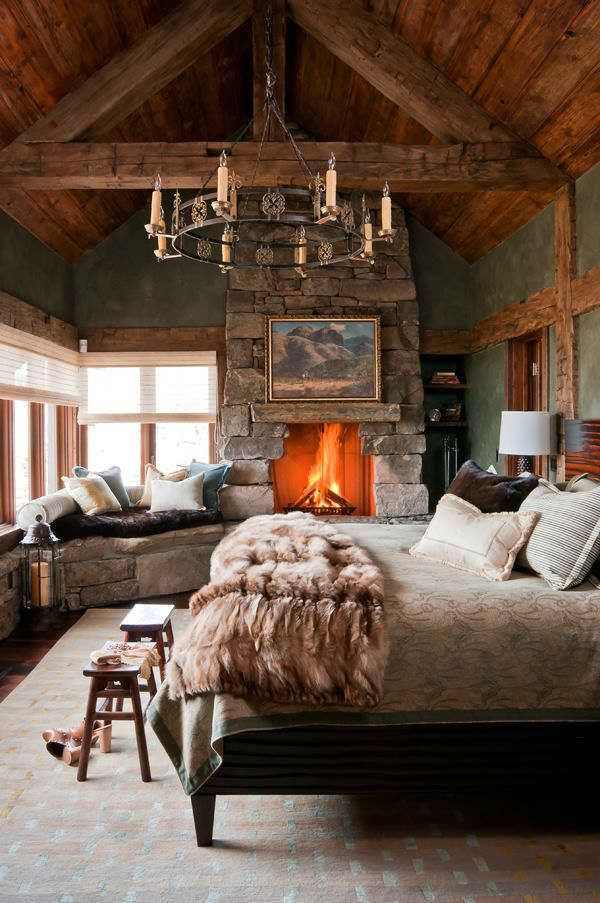 rustic cabin bedroom cozy fur decor fireplace ideas stone wooden beams