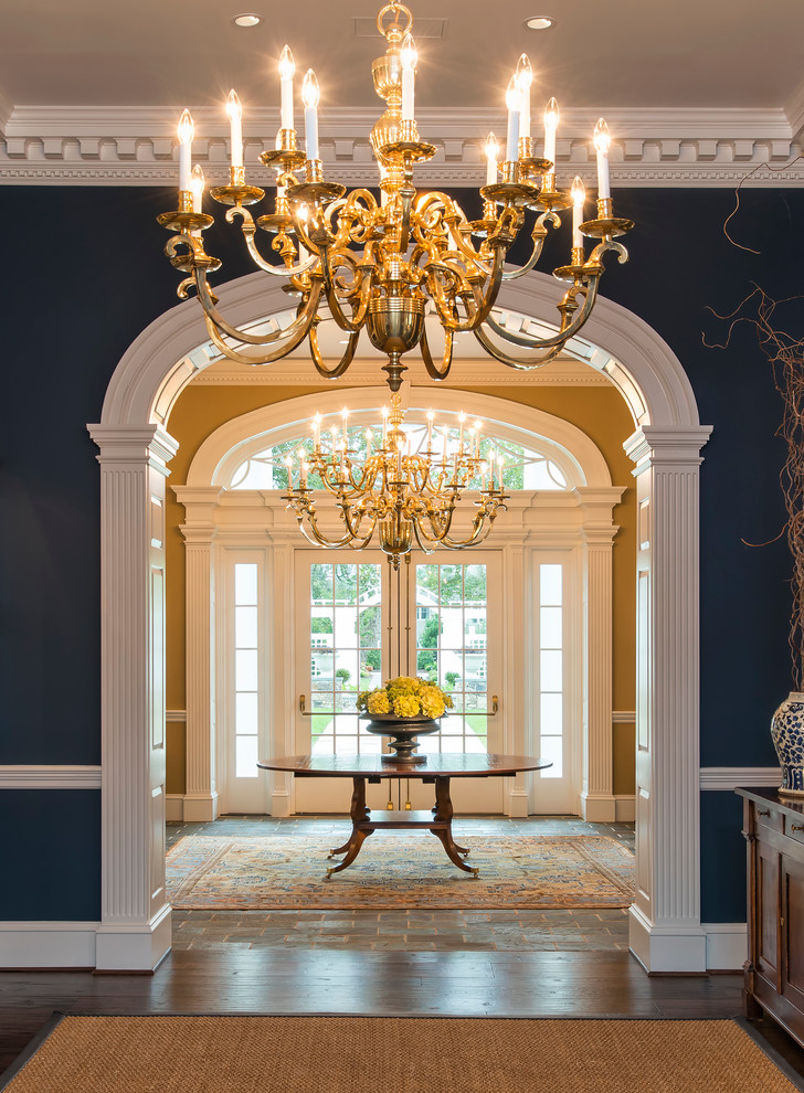 navy blue walls front entrance chandelier decor