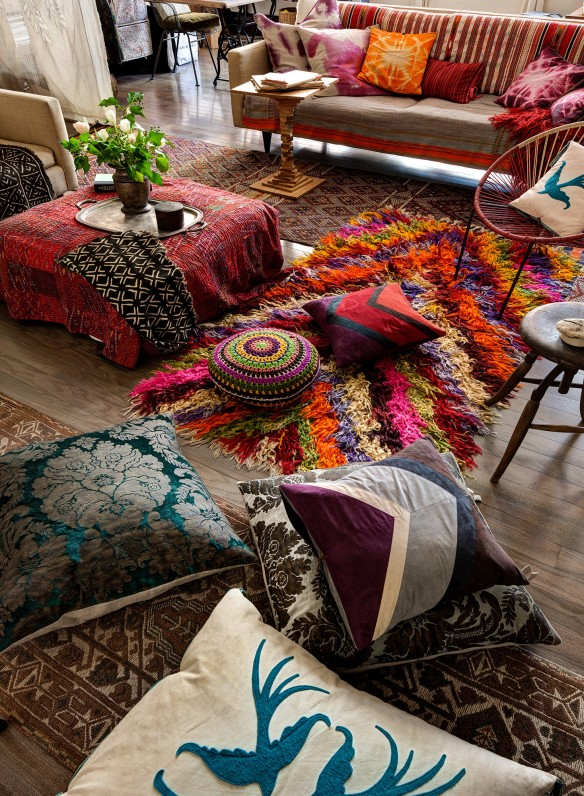bohemian living room decorating full of rugs layering