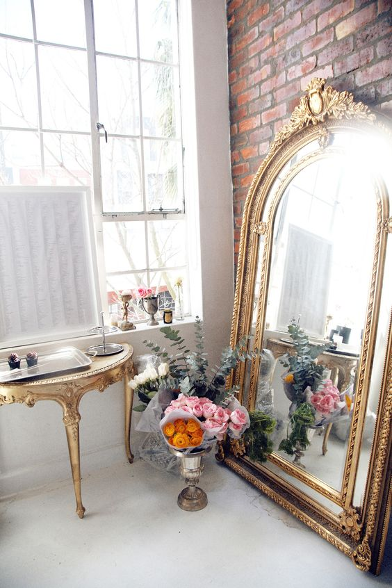 large-gold-mirror-leaning-on-wall-decorating-ideas